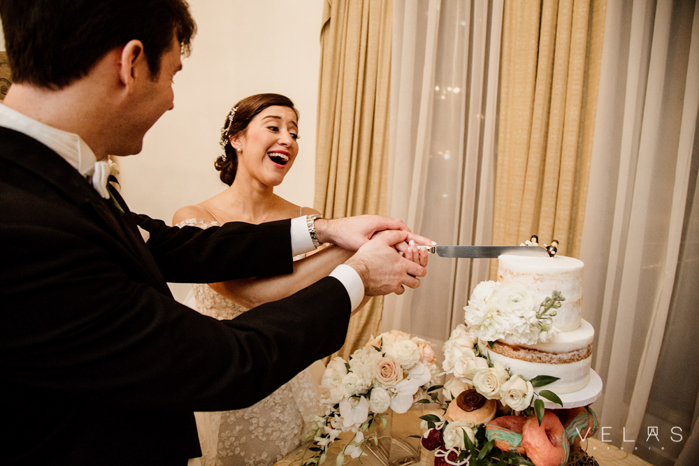 Bride and groom cut the cake at The Wimbish House.