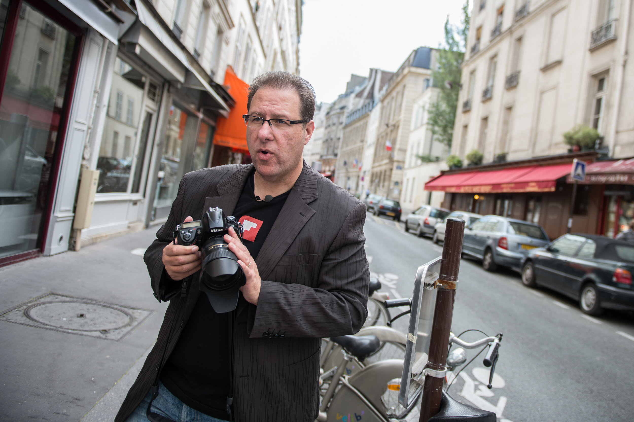 Scott on the streets of Paris teaching travel photography