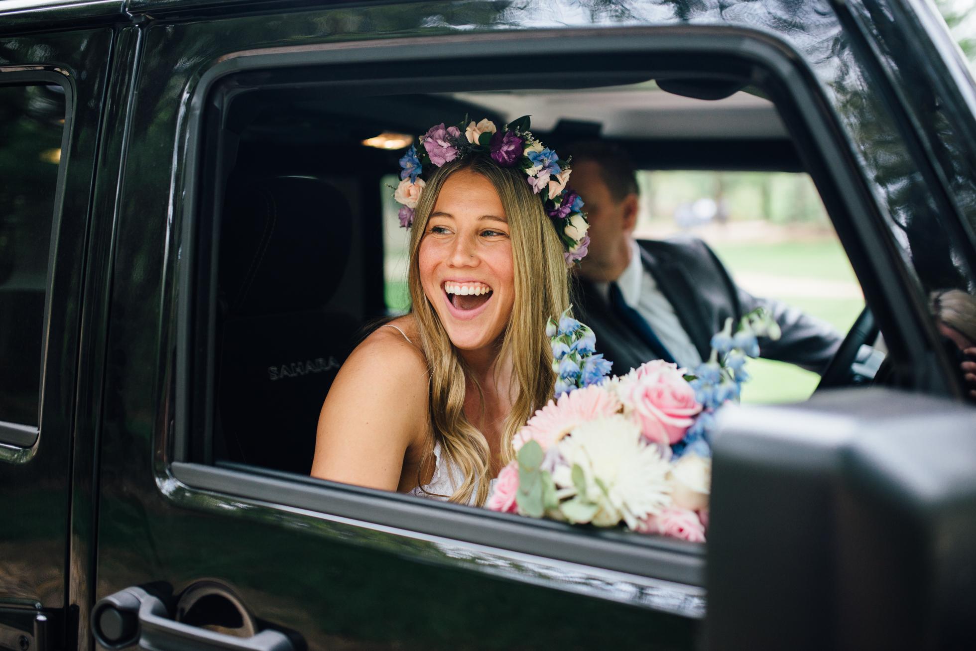 Fernwood Hills London Ontario Bohemian Wedding - Bride arriving in a Jeep