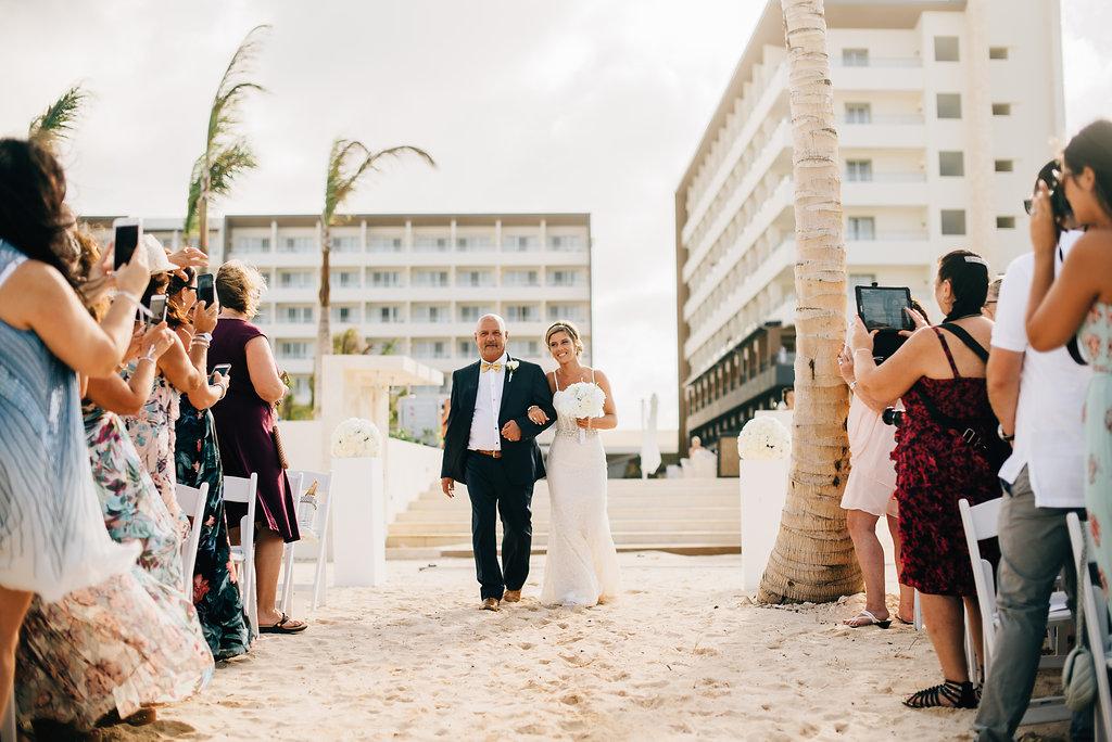 bride walking down the asile at Royalton White Sands in Montego Bay, Jamaica