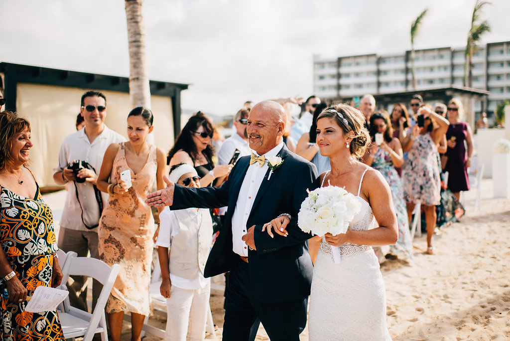 bride walking down the aisle at Royalton White Sands in Montego Bay, Jamaica
