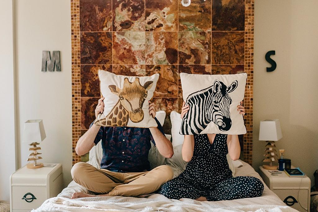 couple-holding-animal-pillows