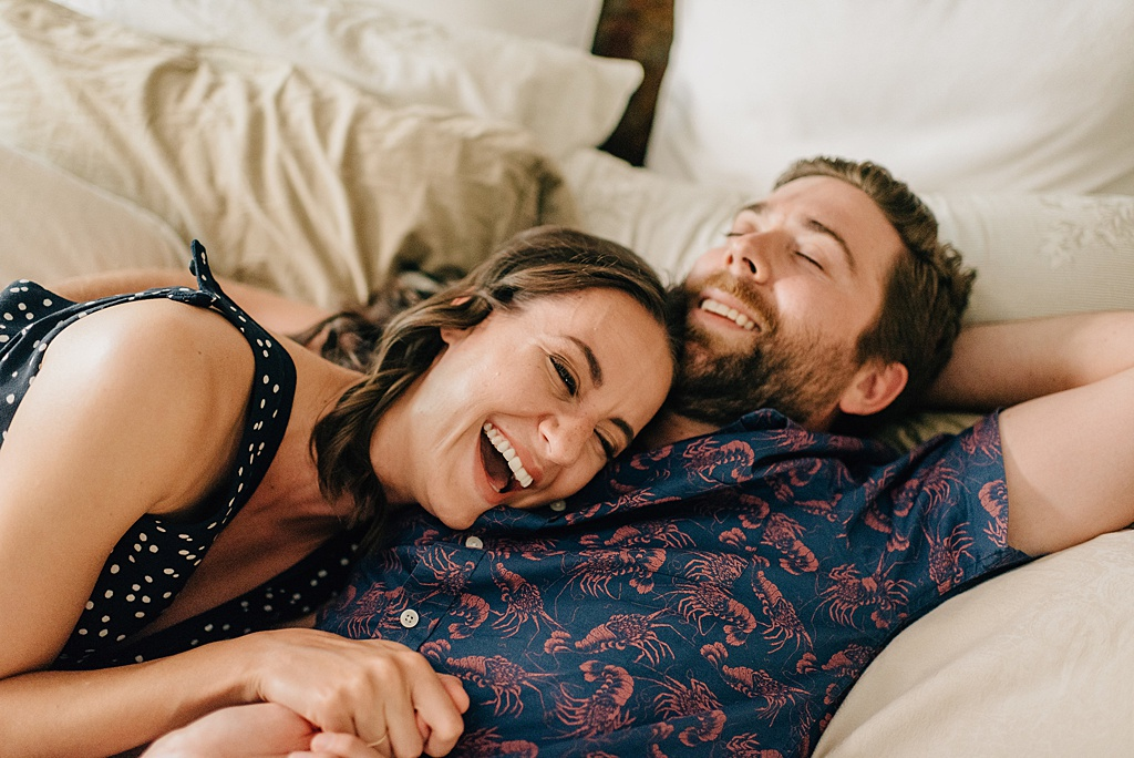 couple-laughing-on-bed