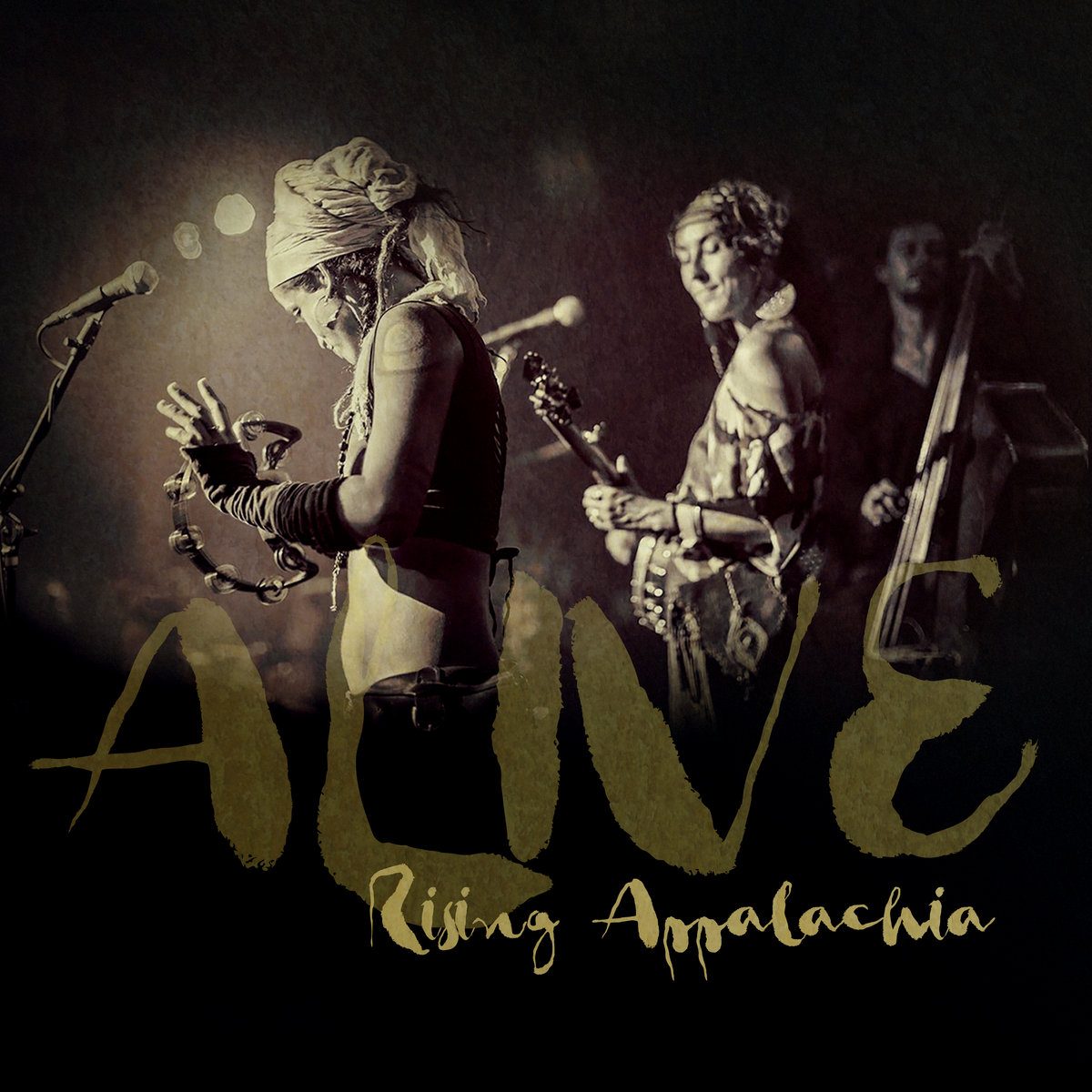Alive - 2017 | Live AlbumCrafted from 2 years of stage serenades from across North America, we give to you our 7th album, ALIVE. Captured from the live lightning bolts that pass between audience and performer in the concert hall, Alive is a magical mixing of free-folk, sister-soul, banjo-bass, and acoustic dance-beat throwdown between the beloved members of Rising Appalachia. Featuring the peppered layers and instrumentation of special guests Arouna Diarra and Ayla Nereo, this album is a compilation of our favorite musical arrangements throughout the years. With these songs we celebrate what makes us truly come alive, rejoicing in our creative and communal shared experience through live song and story.