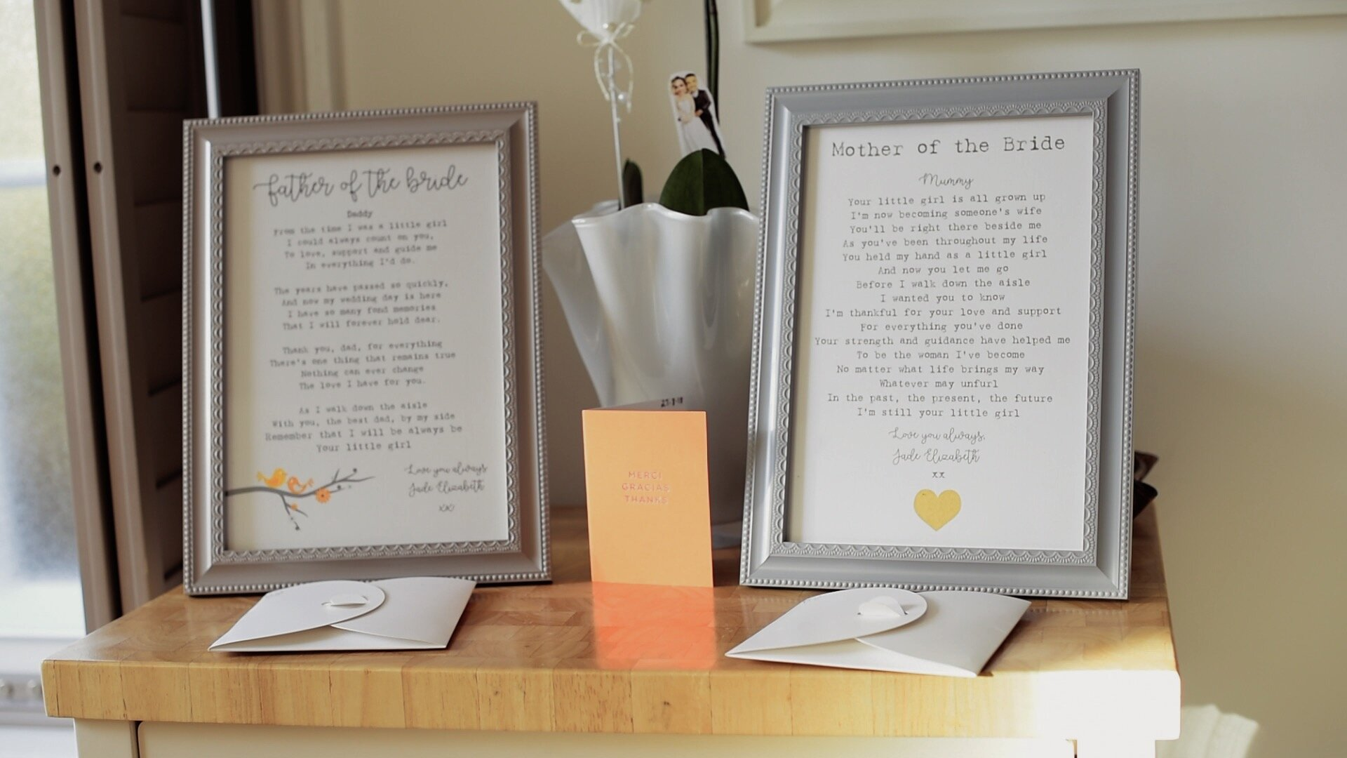 The Brides gifts for her mother and father. They are two framed images of bespoke letters she has written to each of them, thanking them for all their work raising her.