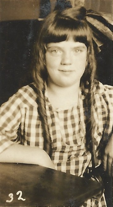 My mother... when she was a cutie in long curls!