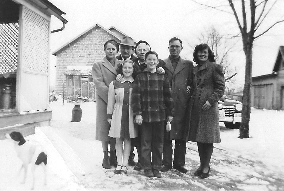 "Our Sunday ""go to church"" family on the farm. Back row, l-r; Aunt Katherine, Uncle Gus, Grandma Louise, Dad George, Mom Muriel. Front row, l-r; Janet, me. On the left, dog Trixie."