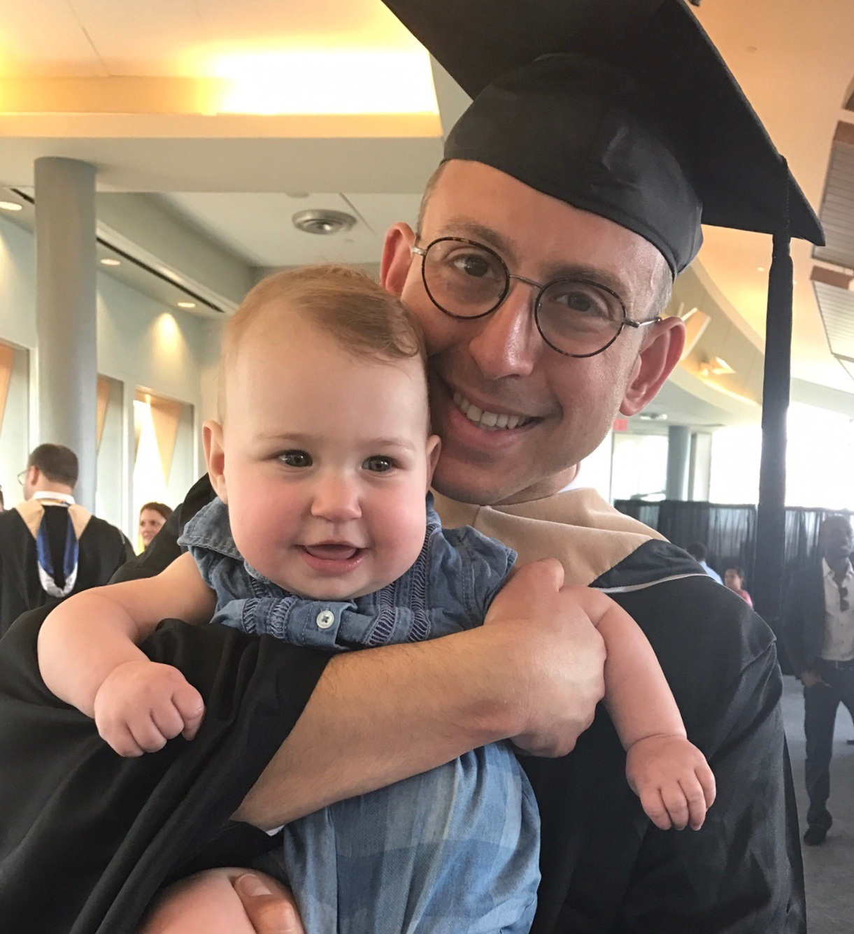 Benjy with our daughter, Adrienne, at his MBA graduation from Georgetown University's McDonough School of Business in May 2017. Hoya Saxa!
