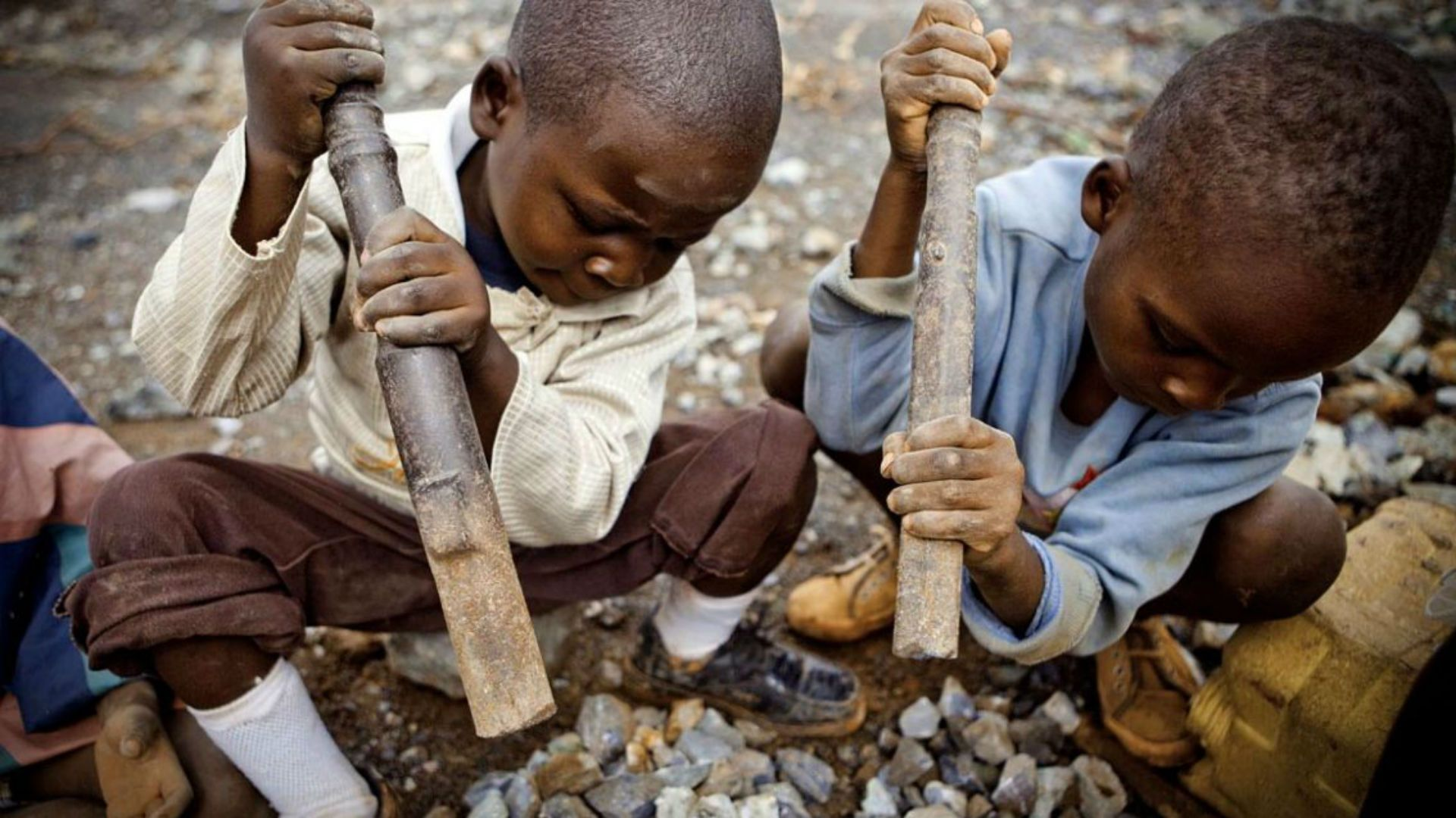 Child labor in the Democratic Republic of Congo supplies cobalt, an essential component of smartphone production, to major multinational technology companies. (AP/Getty Images)