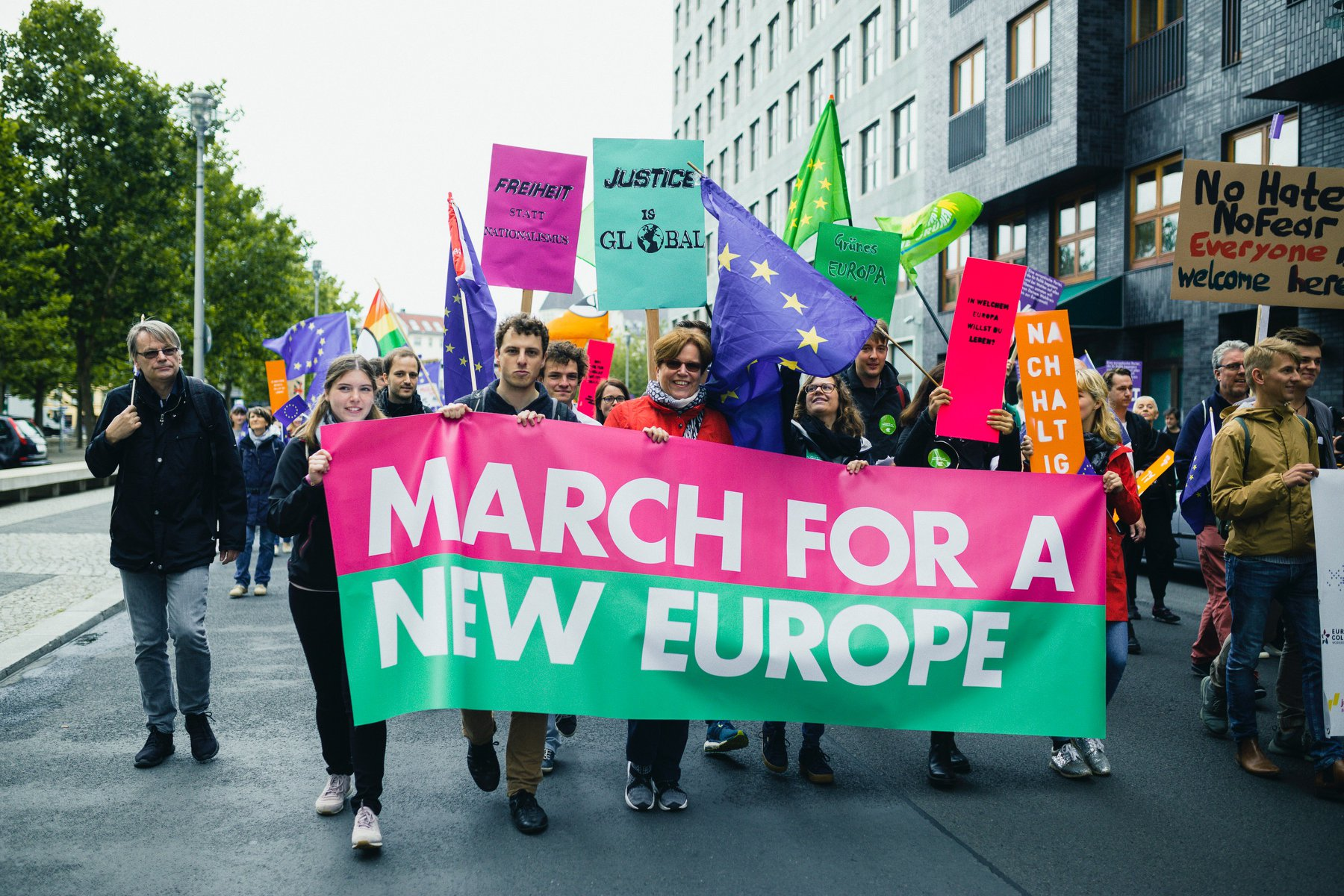 Justice is Global supporters marching in Berlin for a new progressive Europe, June 2018.