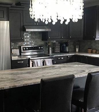 Photo from  LaSalle  small kitchen remodel.  Terra Bianca  stone countertops and taupe-grey shaker style cabinets.
