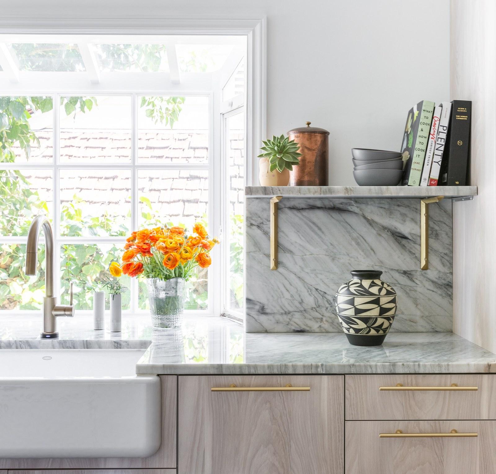 Quartzite countertop, backsplash, and floating shelf. Photo via  Architectural Digest