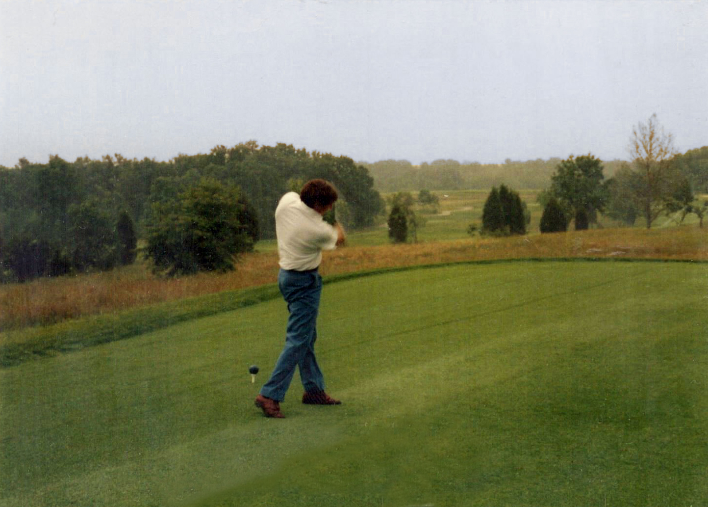 Elmore Just hits the first tee shot on opening day, 1989.