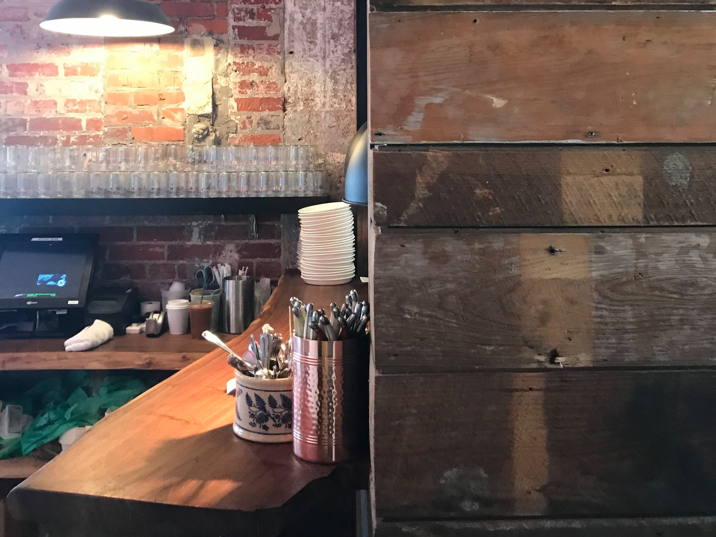 commune-nfk-reclaimed-wood-wall-view.JPG