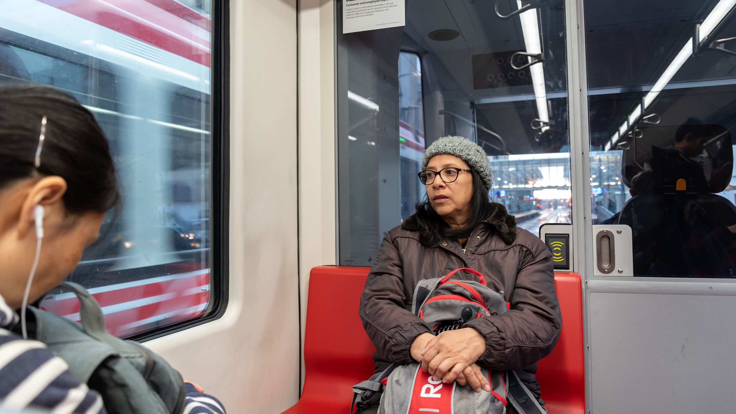 Ana Martinez, a child care worker, is photographed as she commutes to her job at Wee Wild Ones Day Care in Calgary on Wednesday, March 27, 2019. Martinez, 61, has worked in child care for 15 years and she plans to retire later this year. (Photo by Jacob MacPherson/SAIT)