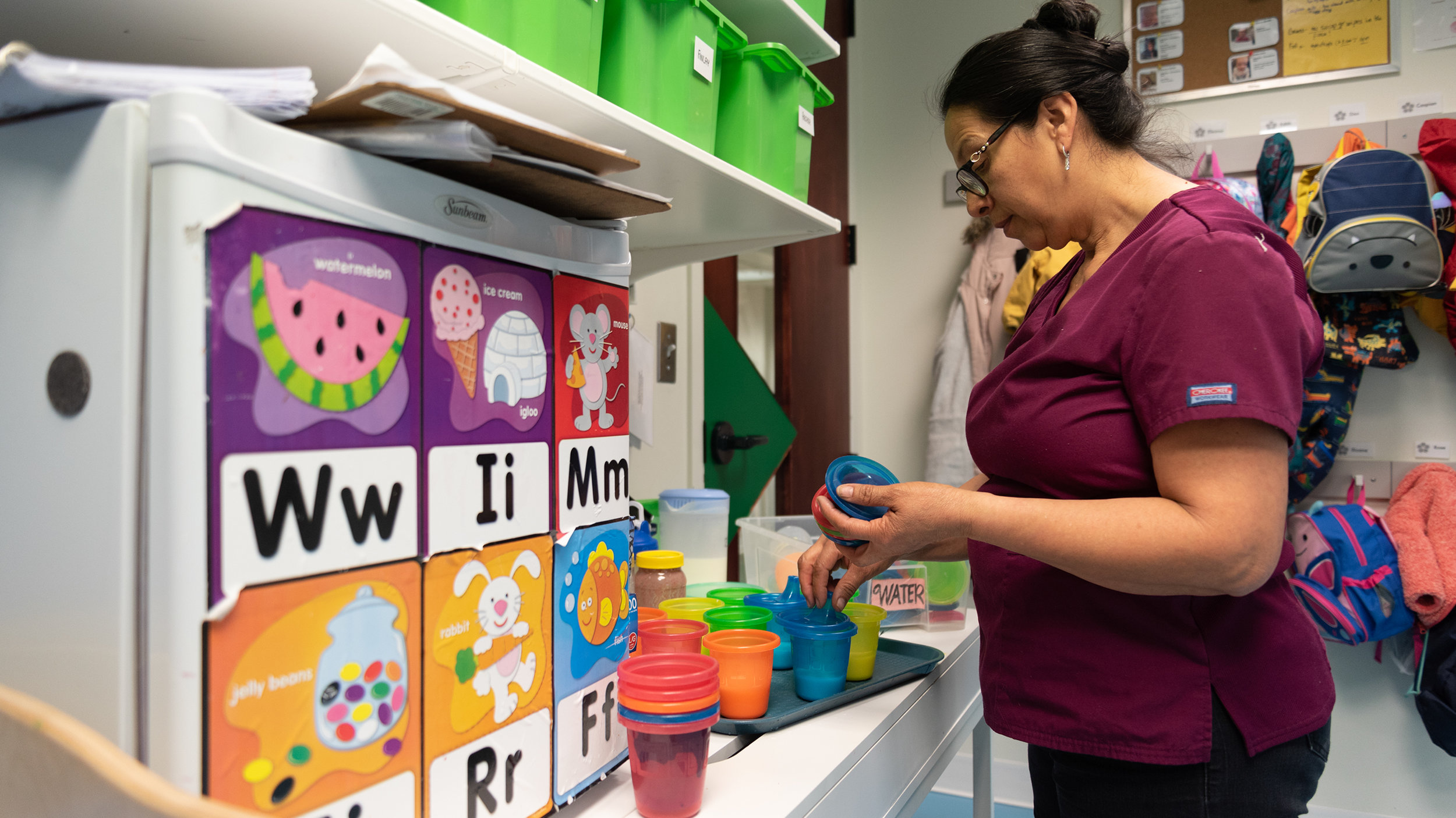 Ana Martinez, a child care worker, spends the morning singing to toddlers and serving the children their morning snacks at Wee Wild Ones Daycare in Calgary on Monday, April 8, 2019.Martinez, a mother of eight children, enjoys working with children, and along side her youngest daughter, Saly, whom also works at the daycare. (Photo by Jacob MacPherson/SAIT)
