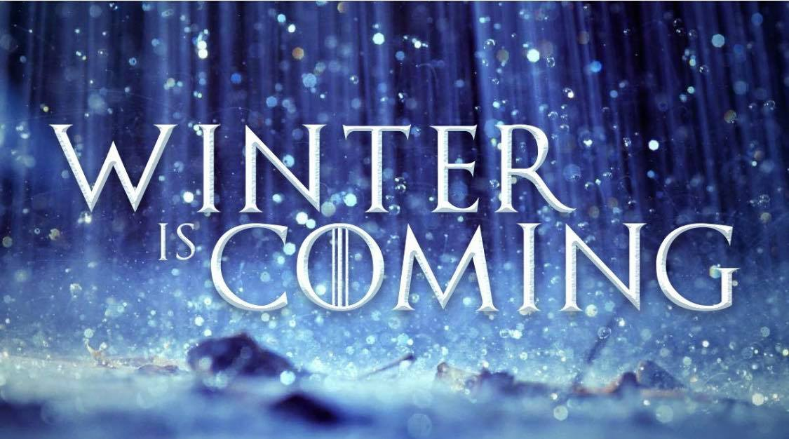 "Photo ID: a snowy and glitter blue background with the words ""winter is coming"" in the center"