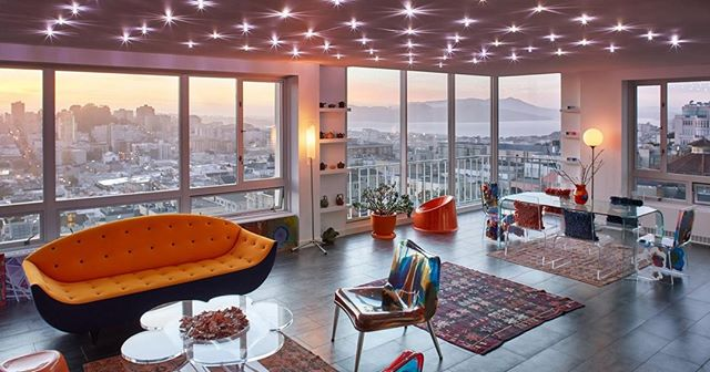 A high-rise condo renovation on Nob Hill that reflects the client's unique taste in modern design and colorful art, all set off by dramatic panoramic views of the Golden Gate Bridge and the Bay.