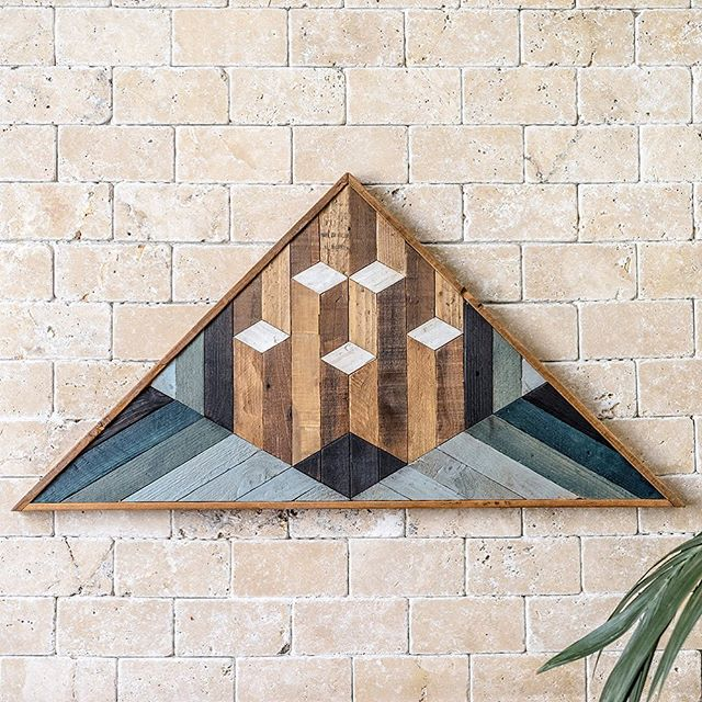 """Talete"" is a piece of triangular-shaped mosaic-style wall art  with an integrated frame, based on a geometric design. It has an ethnic, tribal nature, following the principles of art deco composition. With a strong visual impact, it leaves the imagination free to wander despite the geometric lines and the rigour of the tessellation. This work of art has been especially designed for those who are seeking new inspiration for their environments and who wish to bring an eco-friendly handmade objet d'art into your spaces, capable of stylishly furnishing them while, at the same time, radiating brightness.  Dimensions Approximately 82cm (32,2"") wide x 42cm (16,5"") tall x 3.5cm (1,4"") deep"