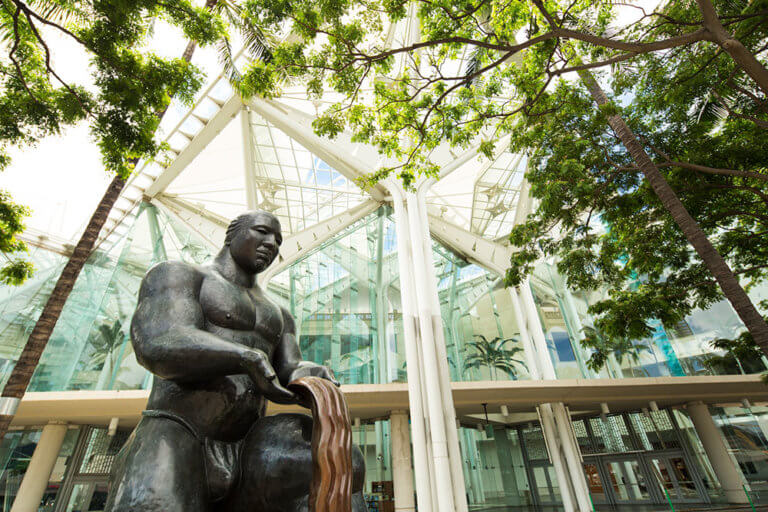 """The entrance to the Hawai'i Convention Center illustrates the facility's commitment to conservation. The statue, called """"Gift of Water"""" by Shige Yamada, ins one of many at the center."""