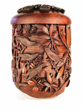 """Artist Scott Hare's milo calabash """"Are We Next,"""" depicts a group of 'i'iwi (the Scarlet Hawaiian honeycreeper, Drepanis coccinea) birds gathered around the last remaining mamo (the Black Hawaiian honeycreeper, Drepanis pacifica) in existence. """"They are asking, 'Are we next?'"""" explains Hare. """"The mamo is now extinct, and the 'i'iwi may follow if we are not careful.""""    Photo courtesy: Scott Hare"""