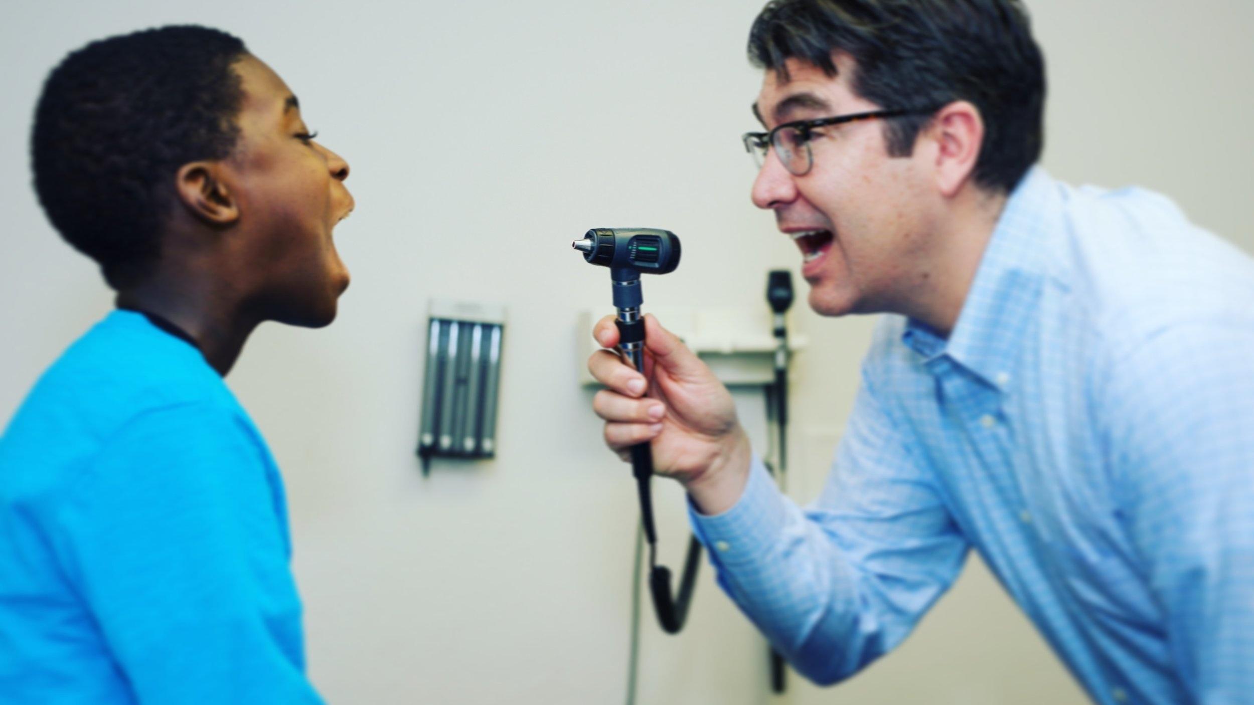 Dr. Mario Gaspar De Alba examines a patient at the UNLV Medicine Ackerman Autism Center