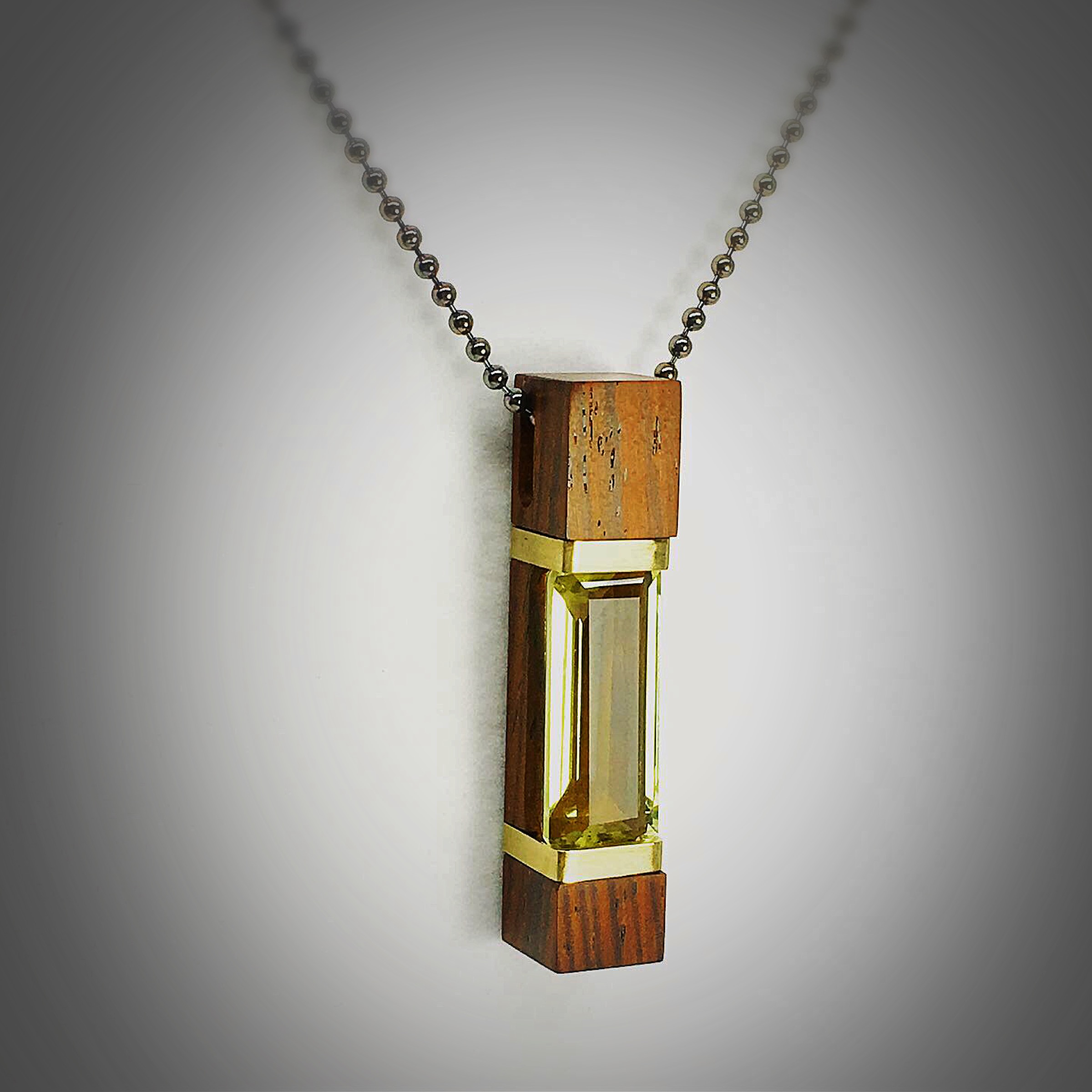 Wood and Peridot Pendant with 18karat gold.JPG