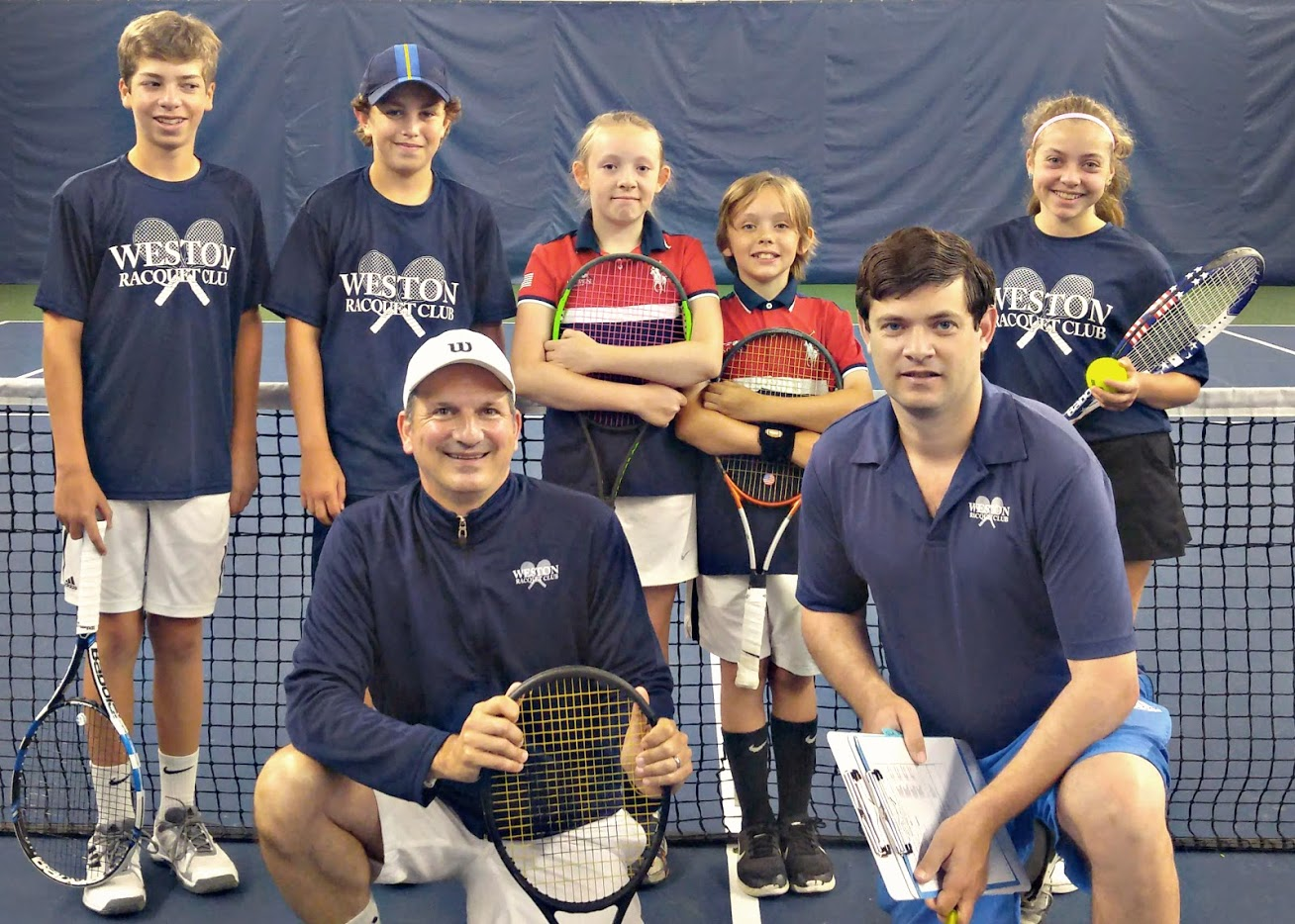 "Caption: Congratulations to the ""Weston Winners"" who clinched the state tennis title going undefeated: L to R (back row) Jackson Carbonier, Billy Mac Clement, Teagan Danzinger, Takoda Danzinger and Calista Finkelstein; (front row) WRC Director of Tennis Angelo A. Rossetti & WRC Coach Jason Fransen"