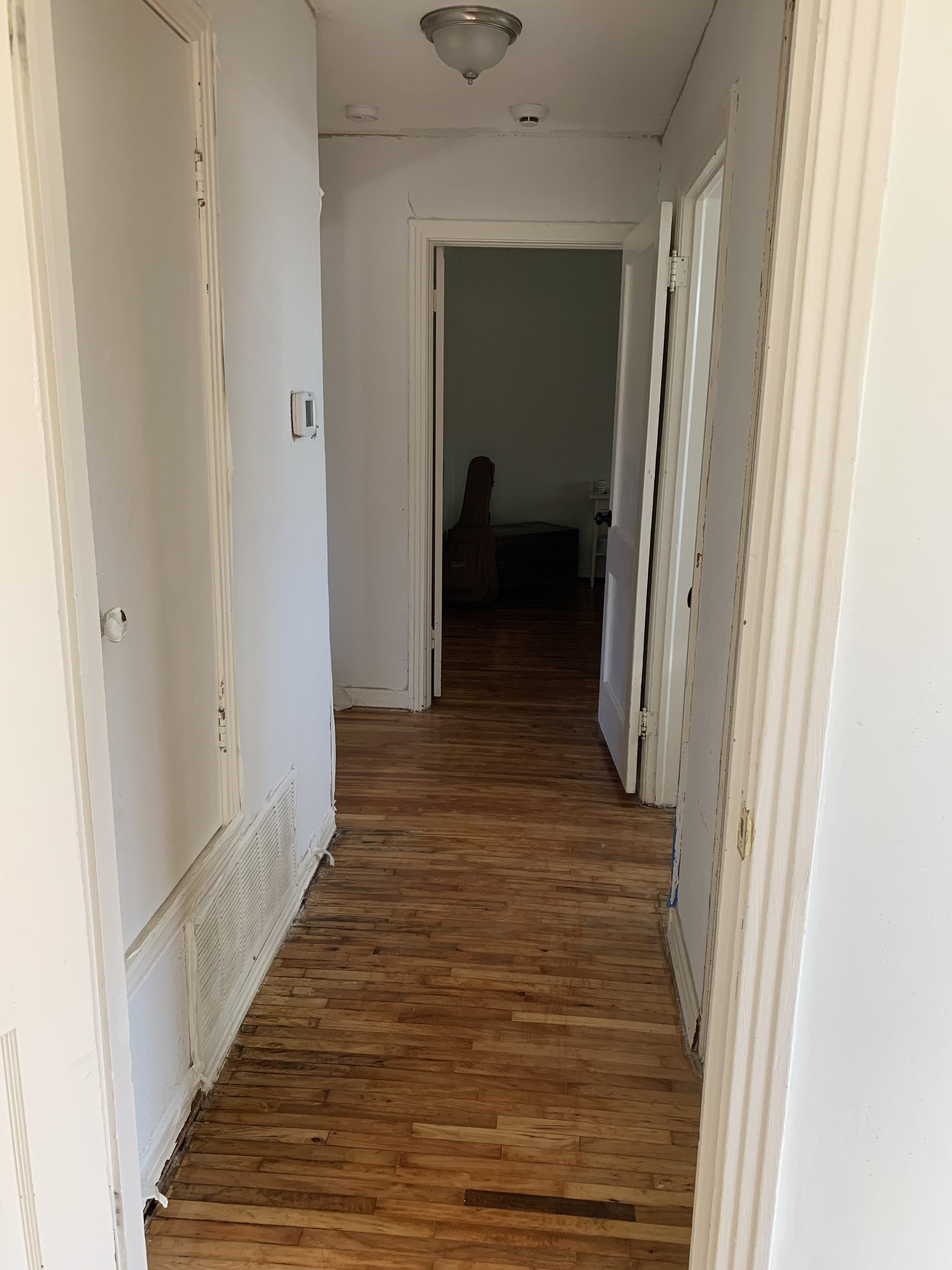 Standing in the office and looking north to the bedroom now. The closet on the left is serving as a linen closet for now. Even just adding the new mud (not painted at all) has brightened the space so much.