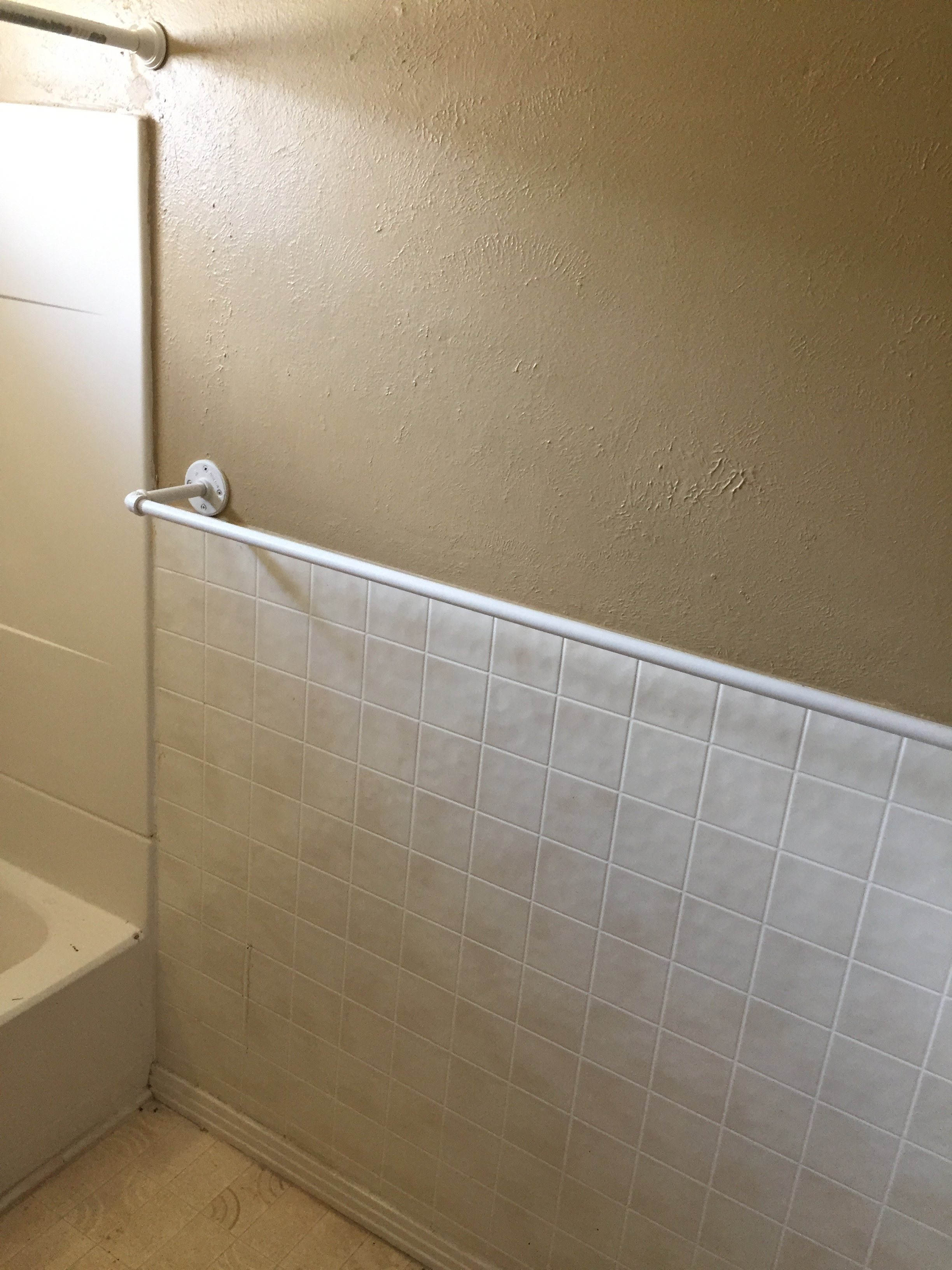 South wall of the bathroom on the day of possession.