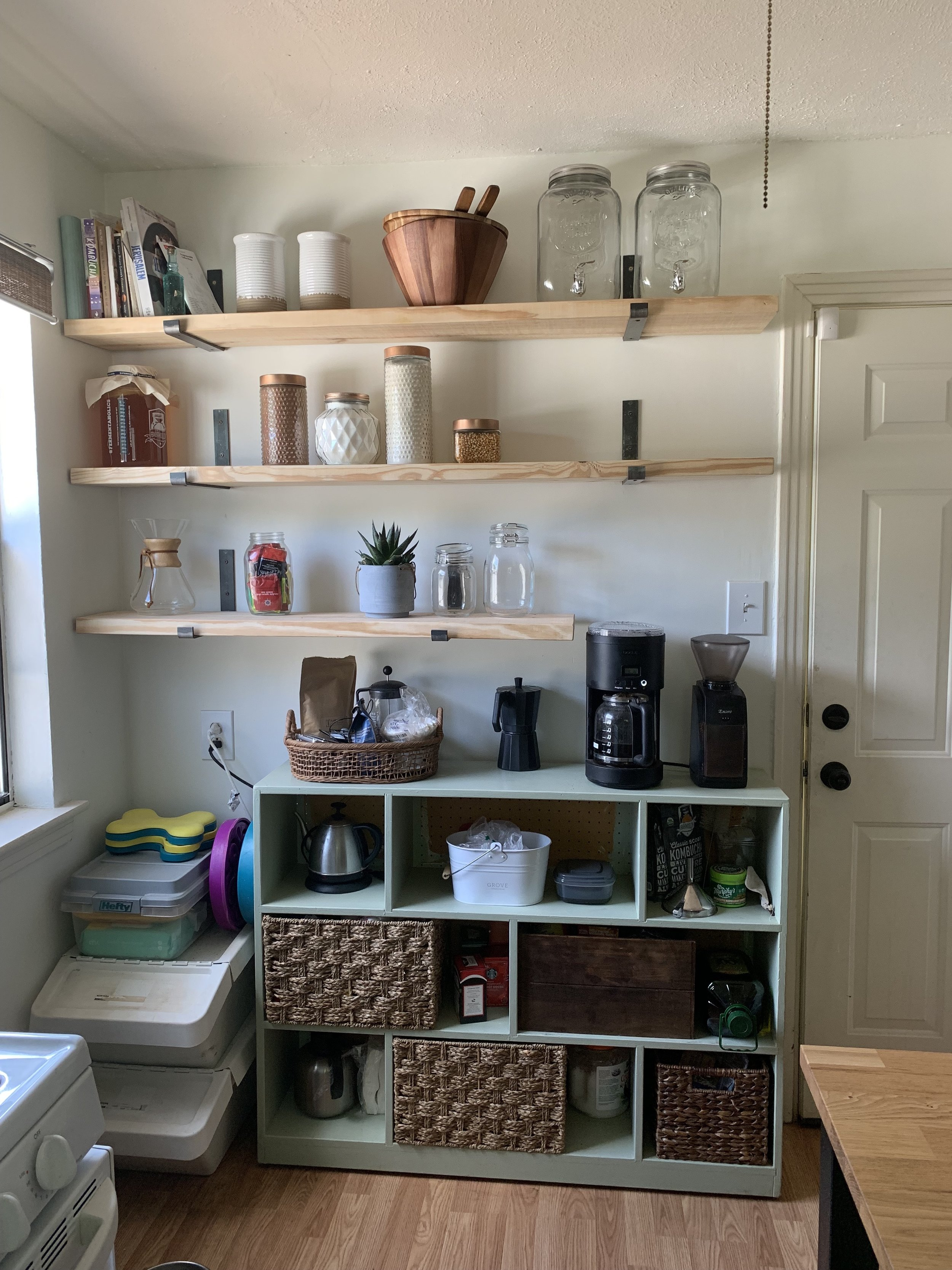 The shelves just went up this week, so I'll be playing with storage and with styling, but MY WORD do I love them. Before, everything was jammed into the green cubes, on the kitchen island, on top of the fridge, and all over the dining table. The raw wood brings a really nice texture to the room.
