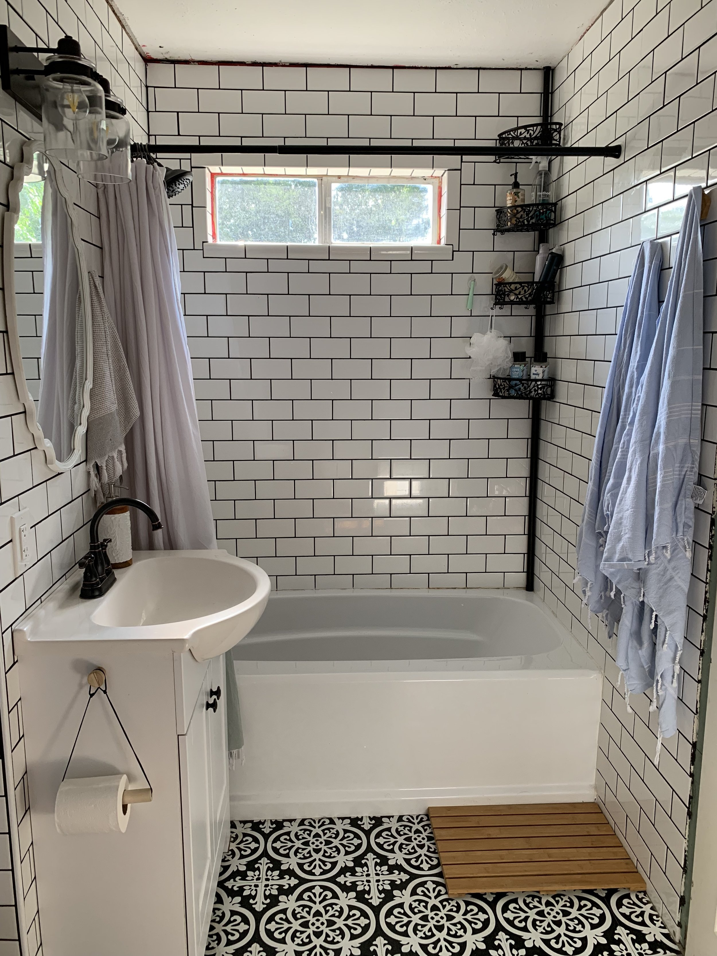 This tile is gorgeous, and I'm beyond proud of Jordan. This bathroom gets filled with natural light every morning! We're planning to put in a wood slat ceiling in a darker stain to counter the clean, modern lines of the tile. Yummy.