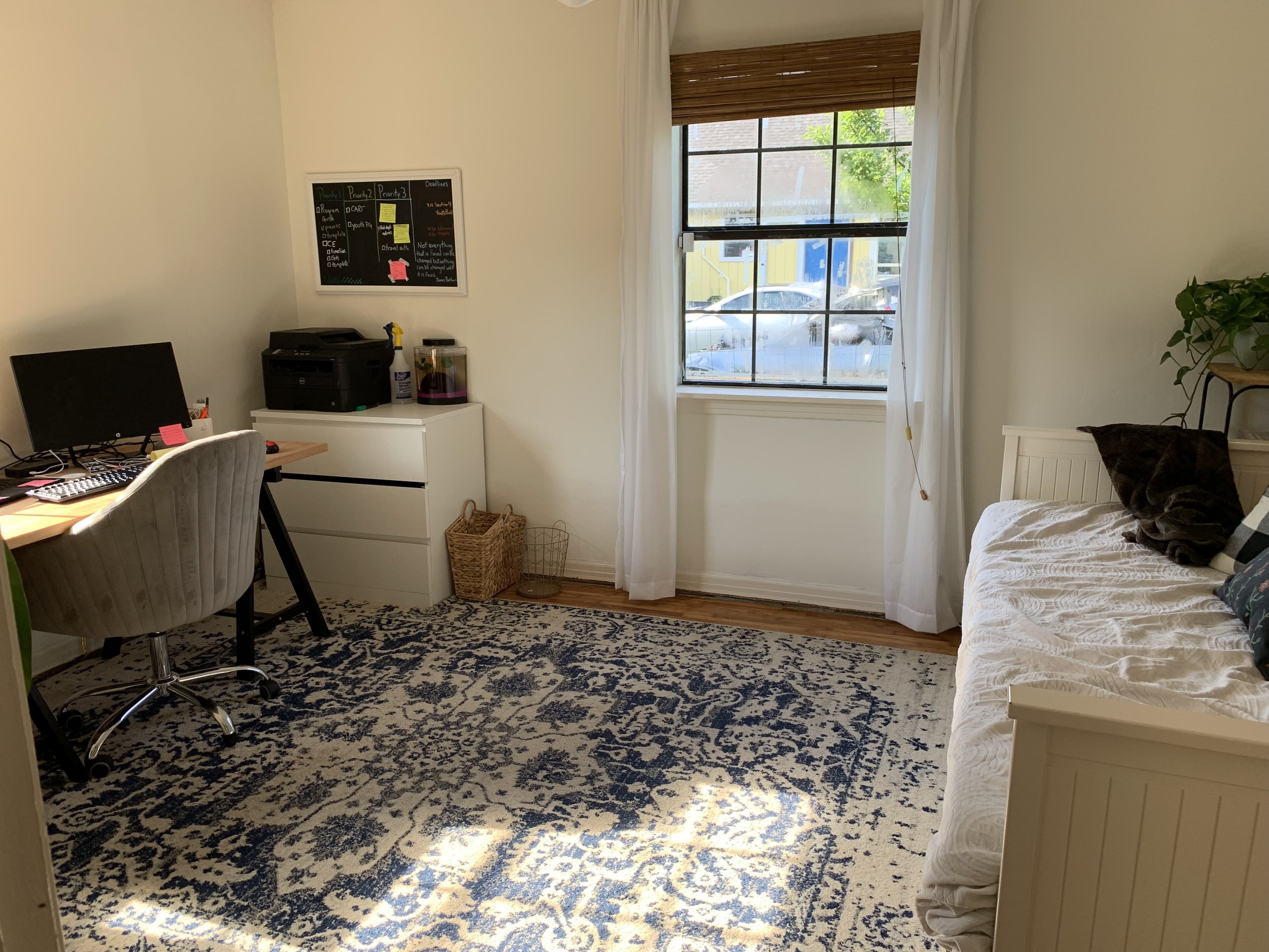 """POWER OF A RUG. I cannot get enough of this rug. It brings two very distinct halves of this multi-purpose room together. In the words of Tim Gunn, """" Cohesionnnnn ."""""""