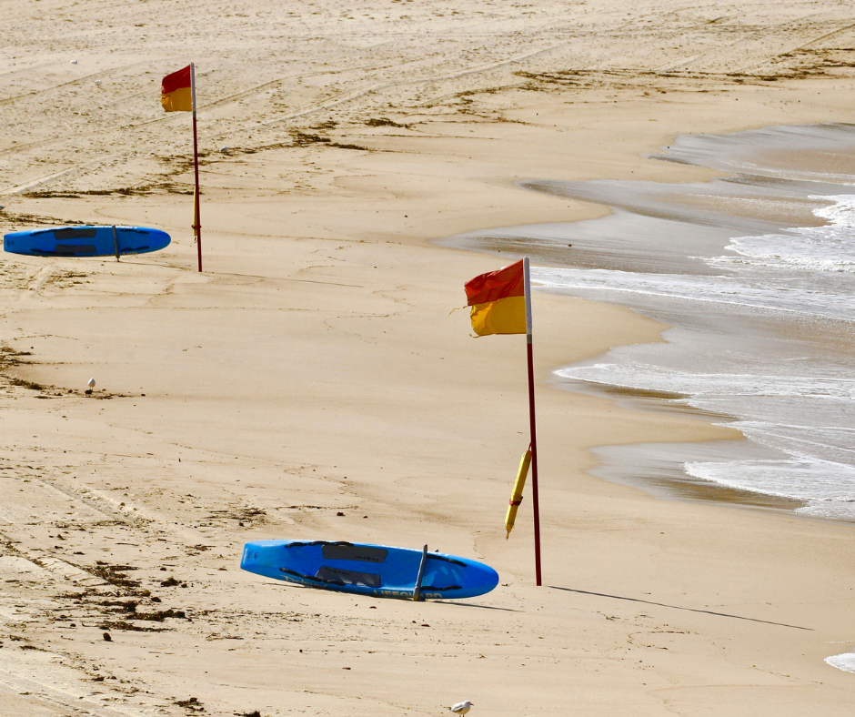 Swim between the red and yellow flags   When you see red and yellow flags on a beach, it indicates that there is currently a lifesaving service operating on that beach. The lifeguards have chosen a section of the beach that is best for swimming and they will closely supervise this area. Lifeguards pay more attention to the area between the red and yellow flags than any other part of the beach.