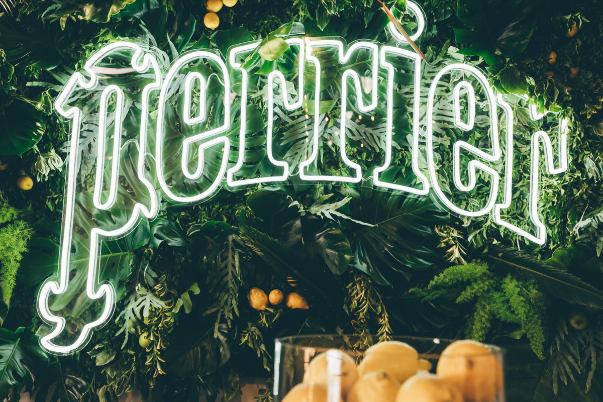 Tropical foliage wall suspended behind the back bar made from real foliage's for Perrier's launch in East London