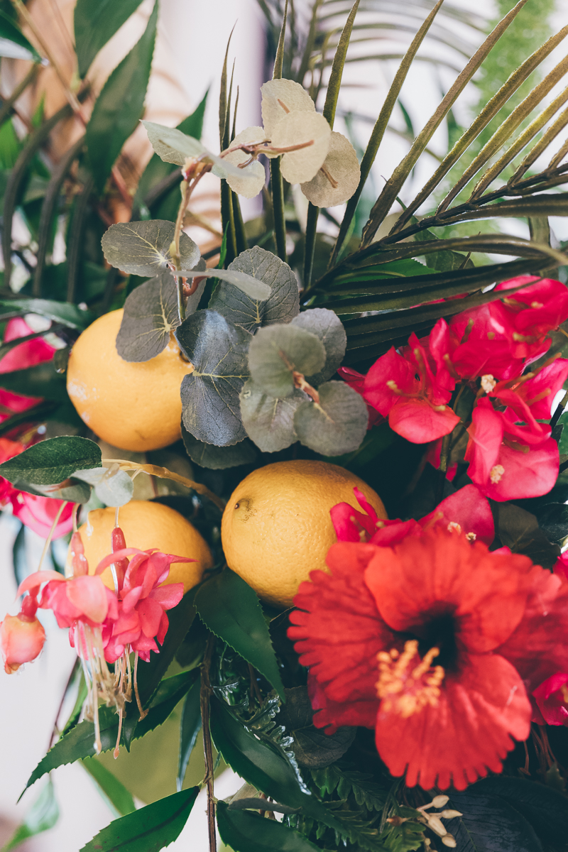 Tropical swings with faux and real foliages and flowers made by Hiding in the City flowers