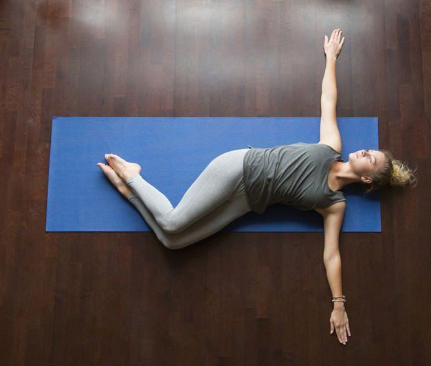 supine spinal twist- yoga for lower back pain.jpeg