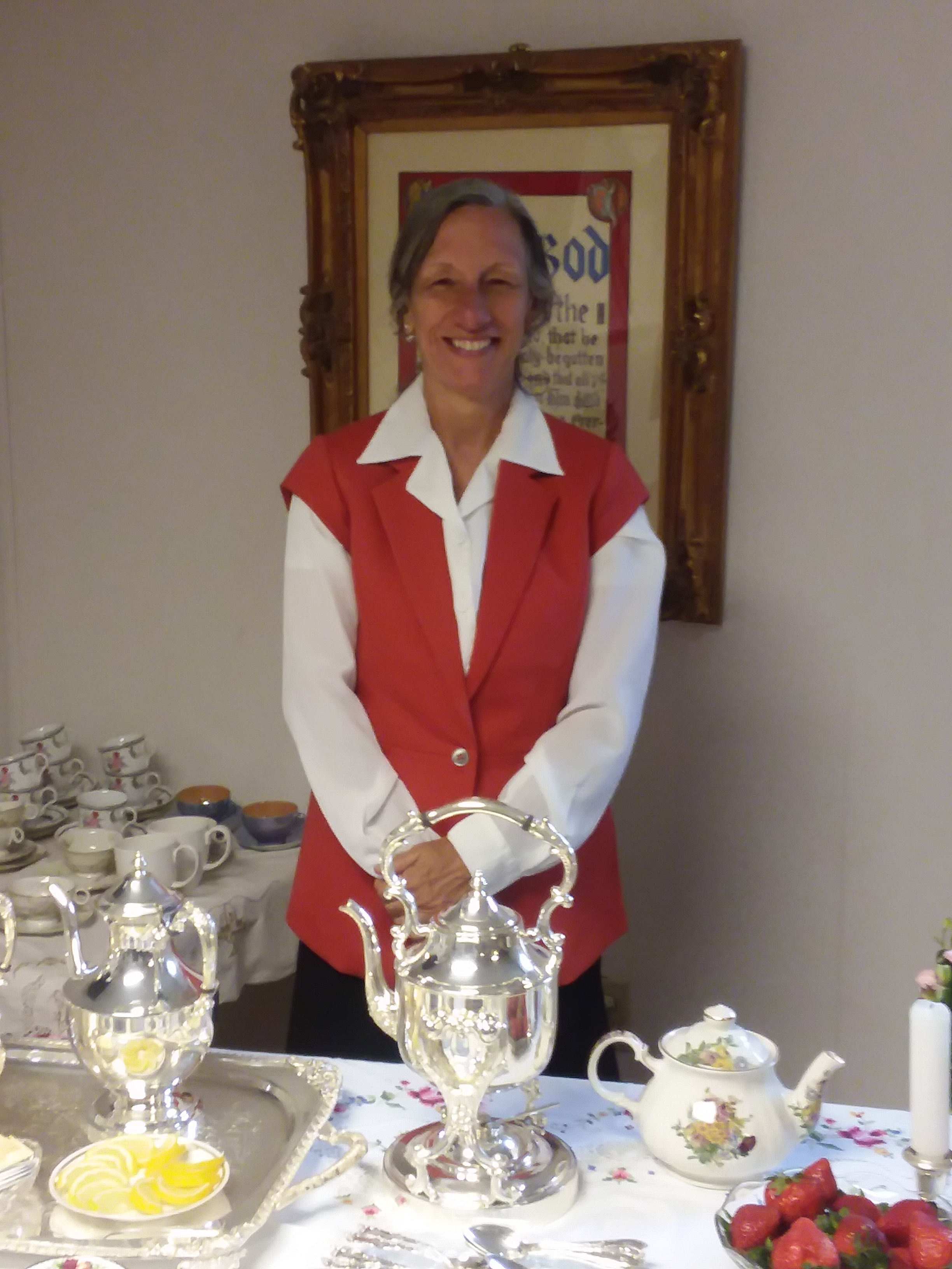 Mary Boitnott serving tea and coffee at the reception for Bishop Morse