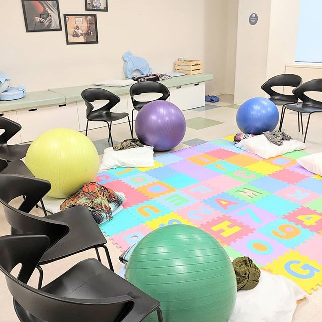 Learning how to use a birth ball during one of our childbirth classes