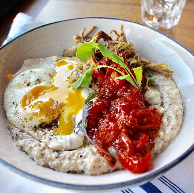 Mix that yolk. #roastpork, local @cvmllc polenta, spicy stewed tomato and peppers, #sunnyegg. #Brunch 'til 3. . . . #keepitsimple #italian #italianfood #brunch #lunch #breakfast #eggs #egg #phillybrunch