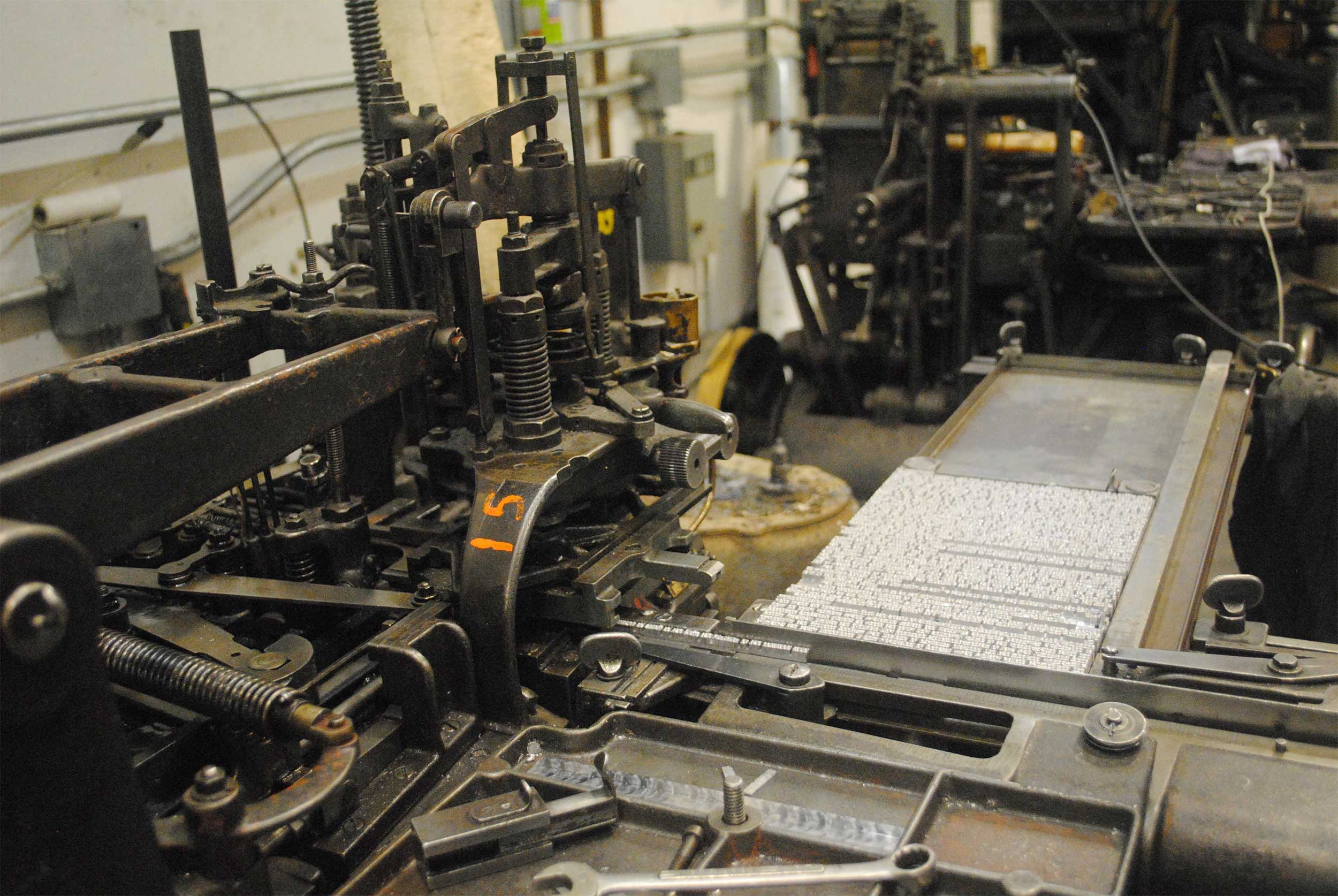 A galley of metal type on the Monotype caster