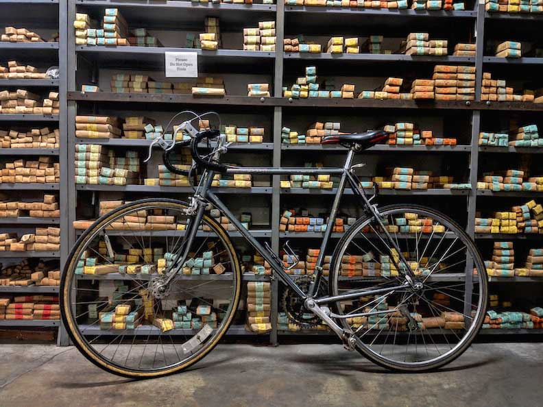 A wall of type and a bicycle at M&H Type