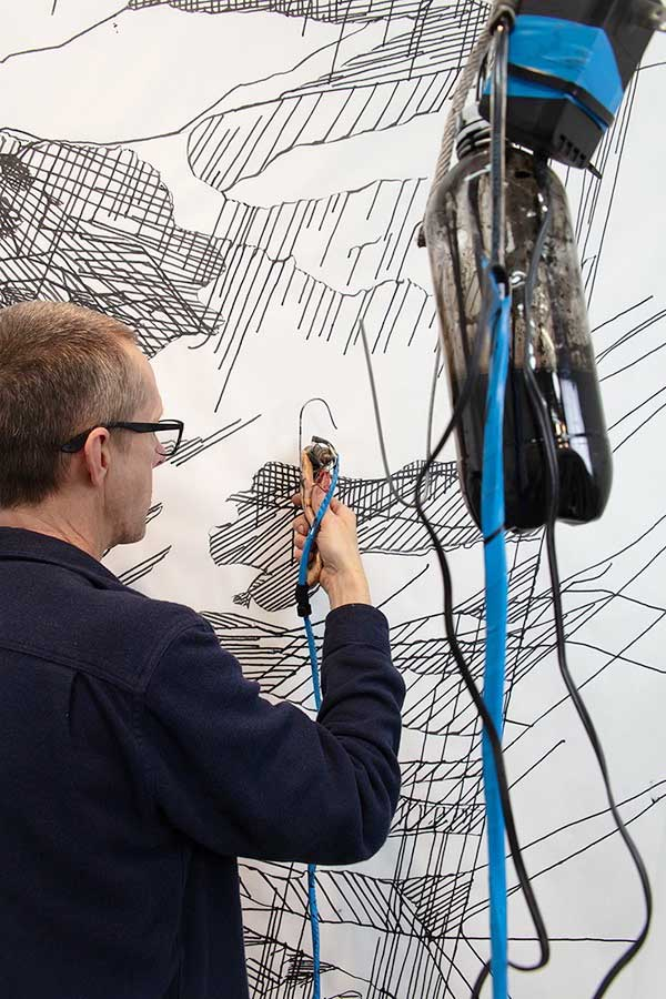 Artist Tim Hawkinson using his gravity-operated hypodermic needle drawing device to create images for the forthcoming 2019 Arion Press edition of  Frankenstein