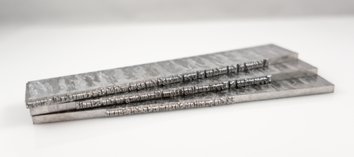 Three Linotype slugs—lines of type cast at once.