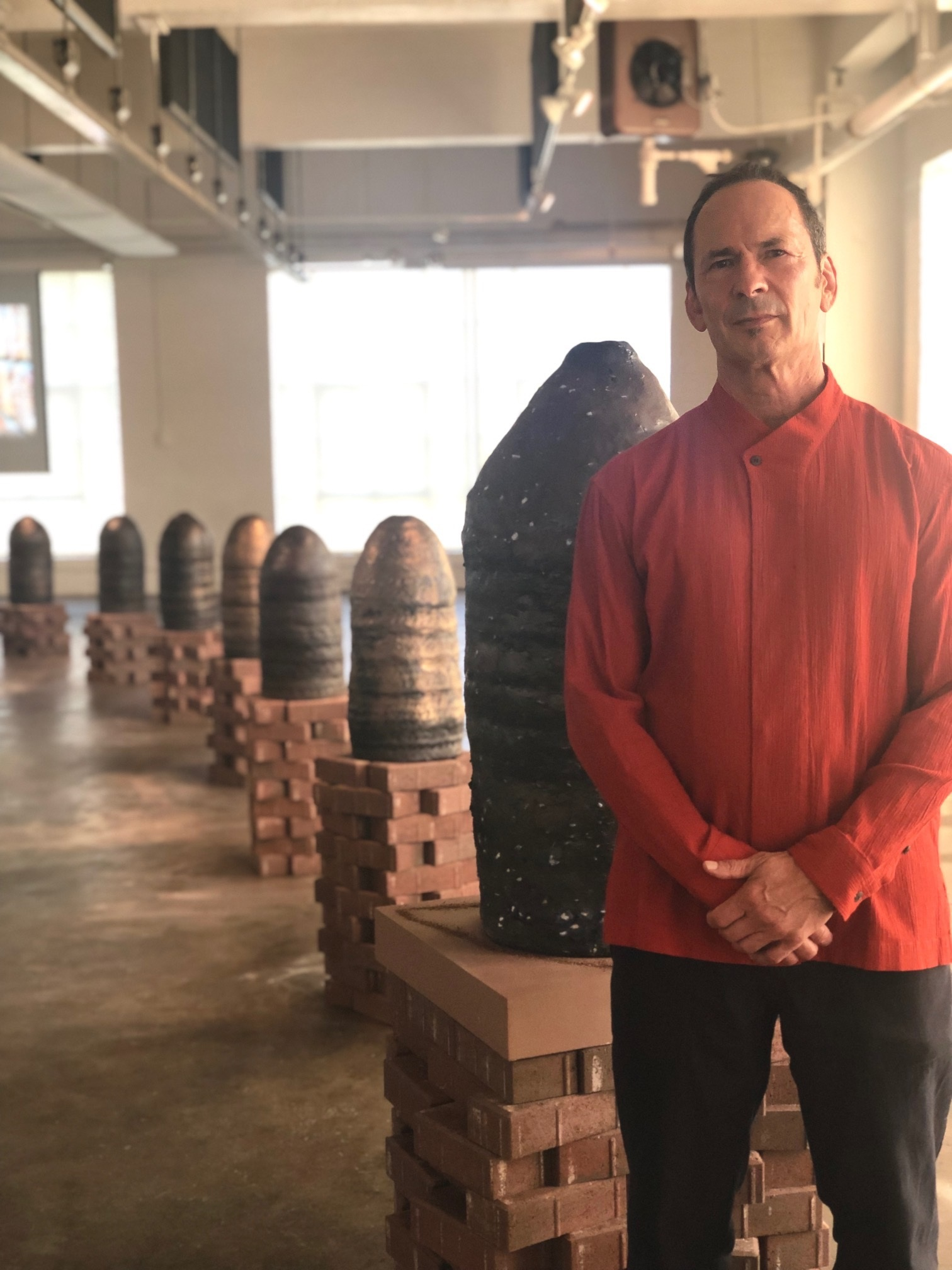 """Pulitzer prize winning writer Forrest Gander at the opening of his collaboration with artist Ashwini Bhat, """"Interior Landscape,"""" in the Grabhorn Institute gallery, Fall 2019"""