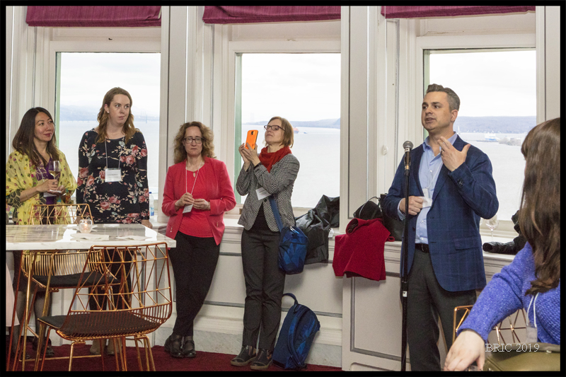Elsevier's Kevin Hames addressing group at social event, with librarians (centre is Joanna Szurmak, from UofT).