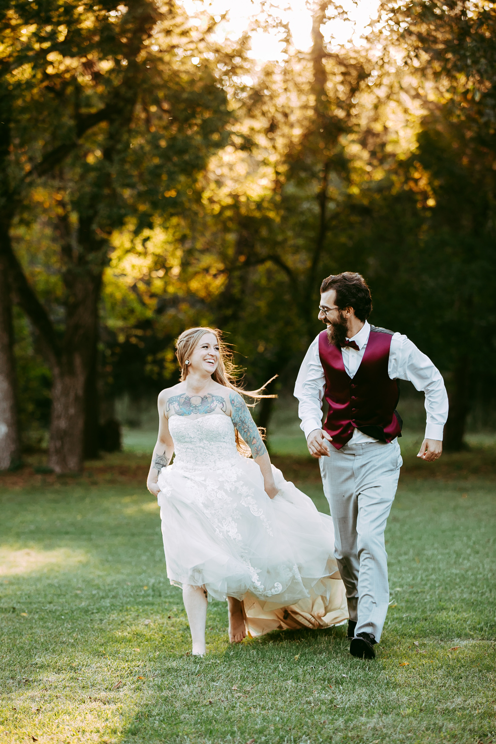 Fun wedding image of bride and groom running while looking at one another at the Ranch of the Saints in Oklahoma, photo by Amanda Lynn.