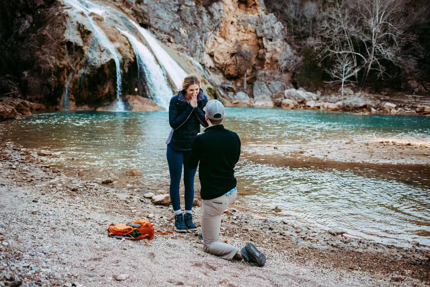 Surprise proposal at Turner Falls in front of the waterfall in Oklahoma.