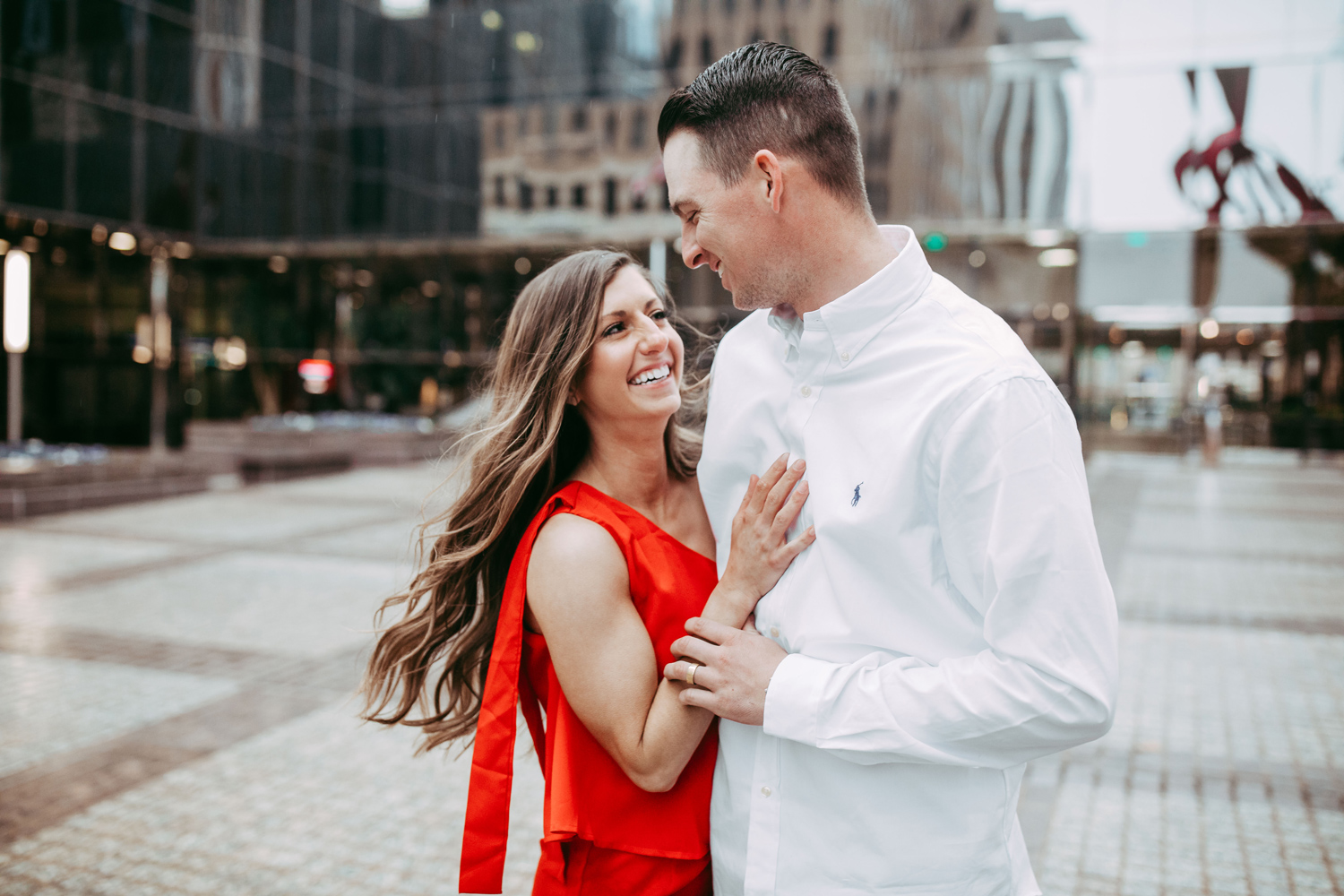 Couple dancing in downtown Oklahoma City by Oklahoma wedding photographer Amanda Lynn.