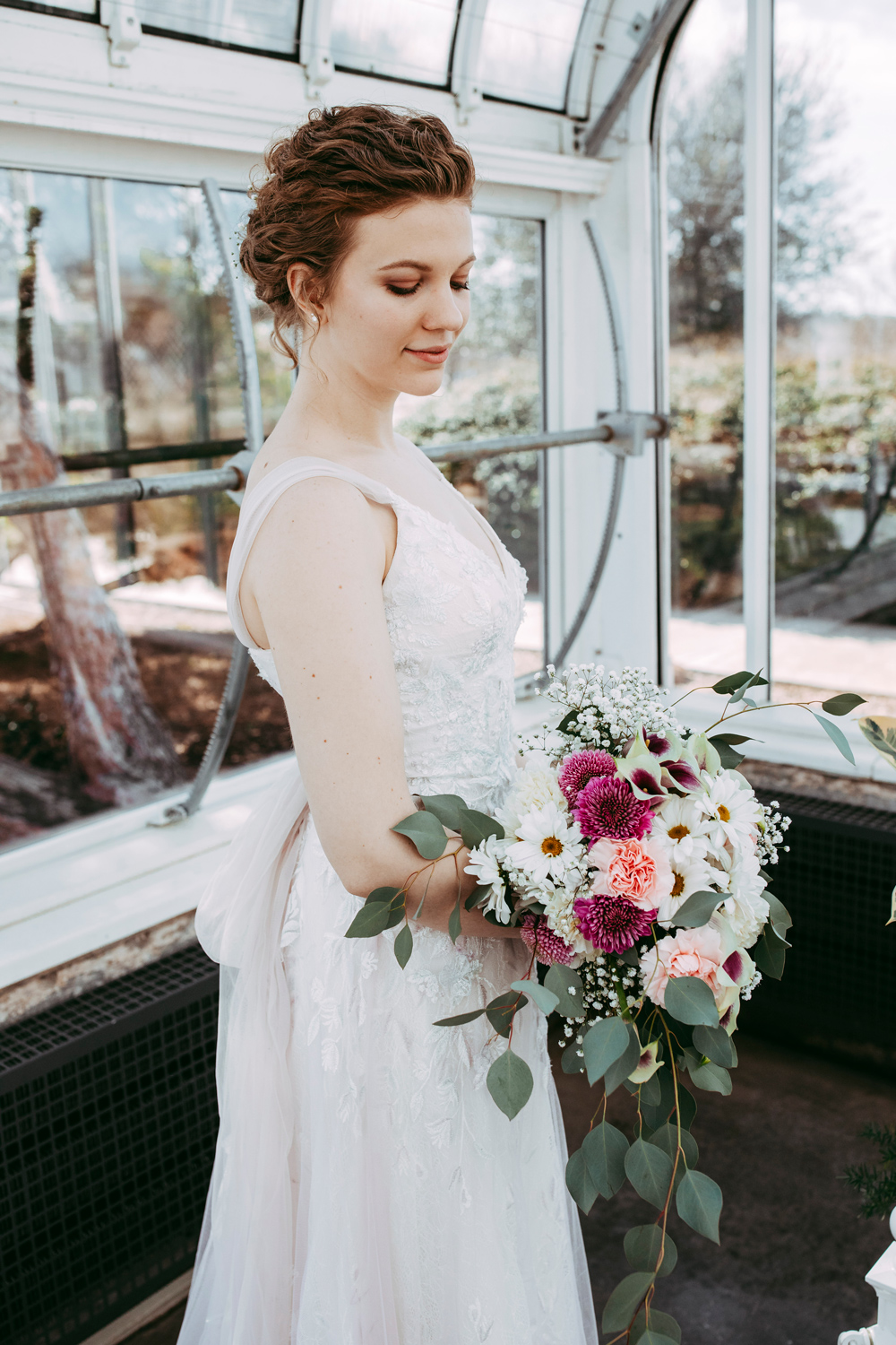 Gorgeous bride photo at the Will Rogers Park Greenhouse in OKC by Amanda Lynn Photography.